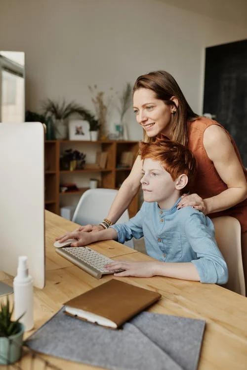 boy does homework online